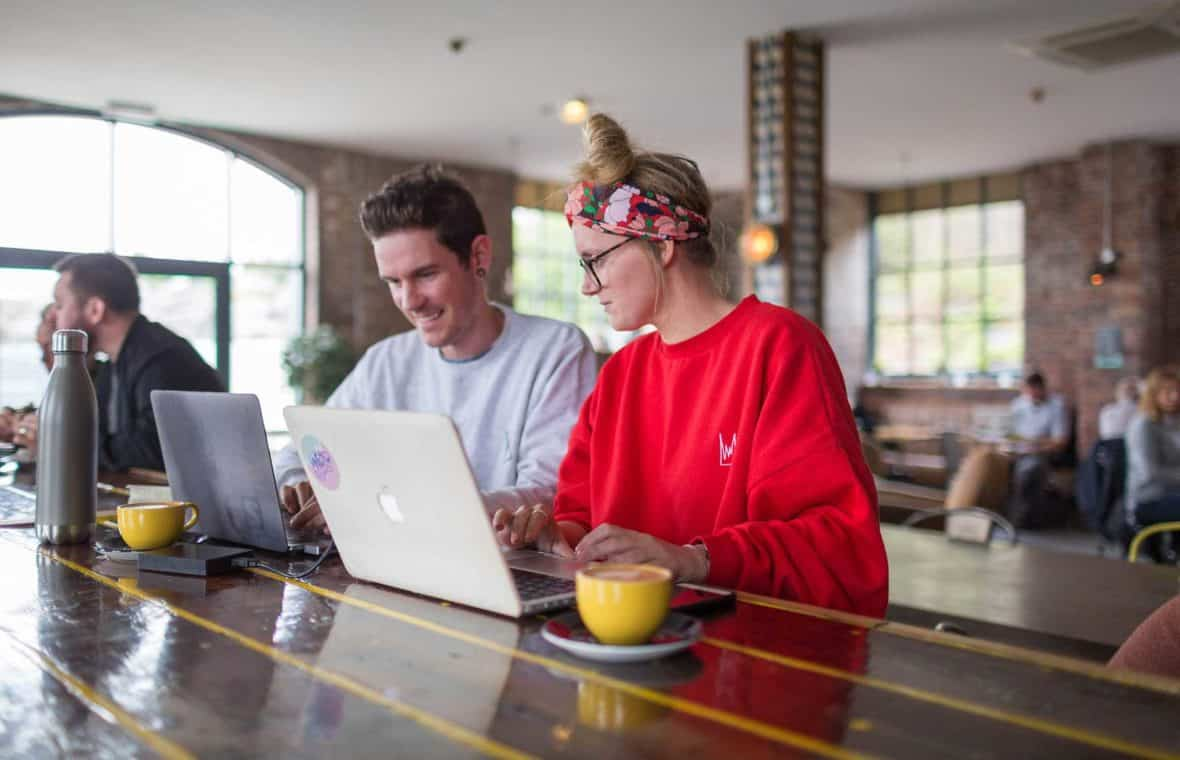 Two people achieving work life balance in coffee shop