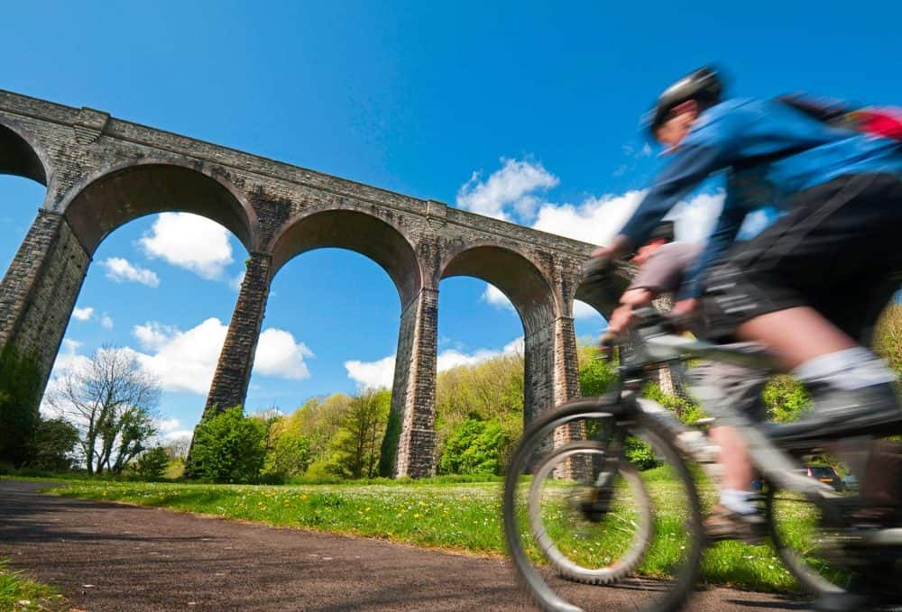 Cyclist in the foreground of Porthkerry viaduct